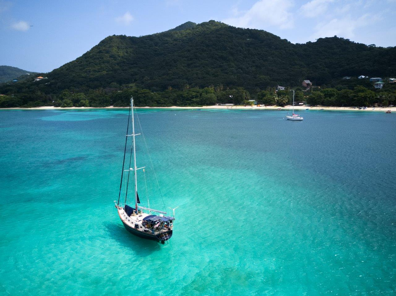 ¡Pura Vida! anchored in L'Esterre Bay by Paradise Beach
