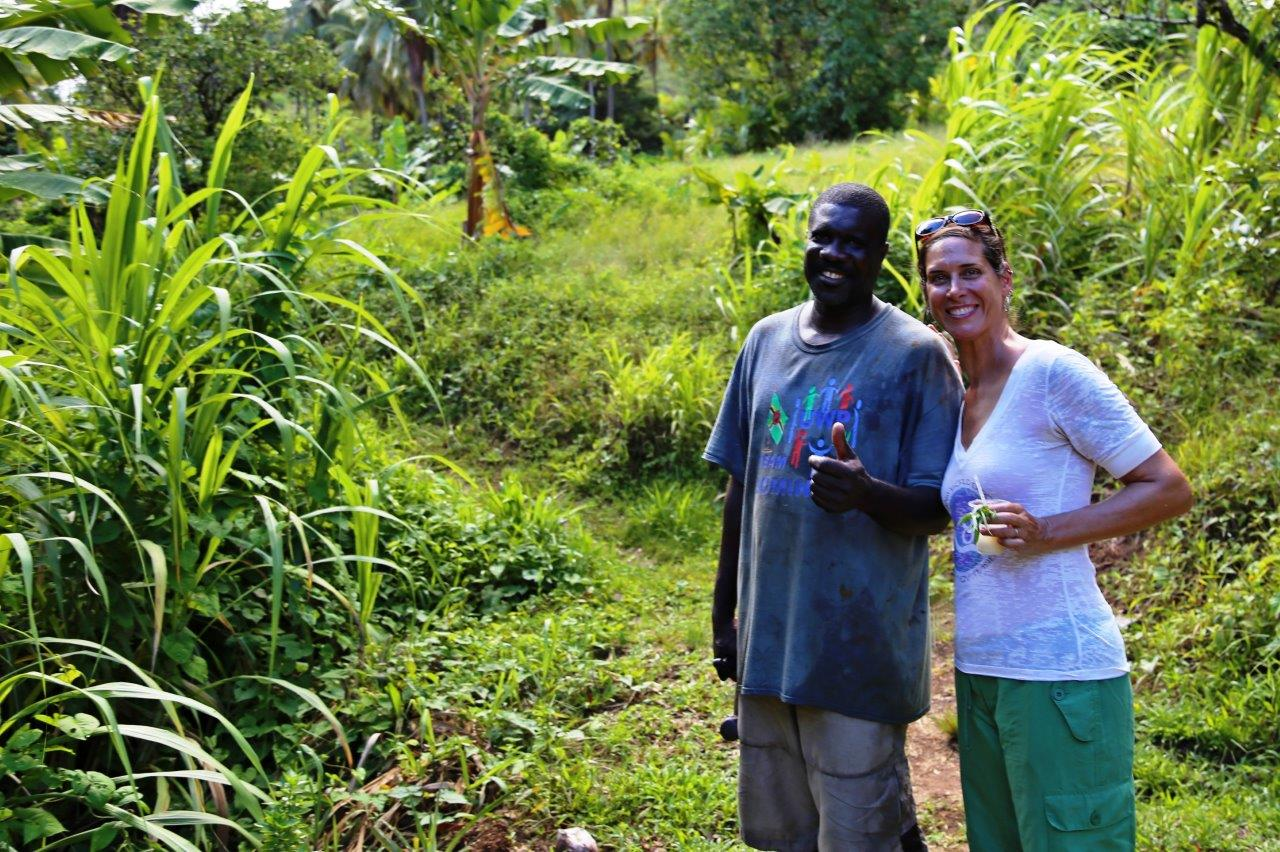 With Leslie, our plantation guide, surrounded by lemongrass