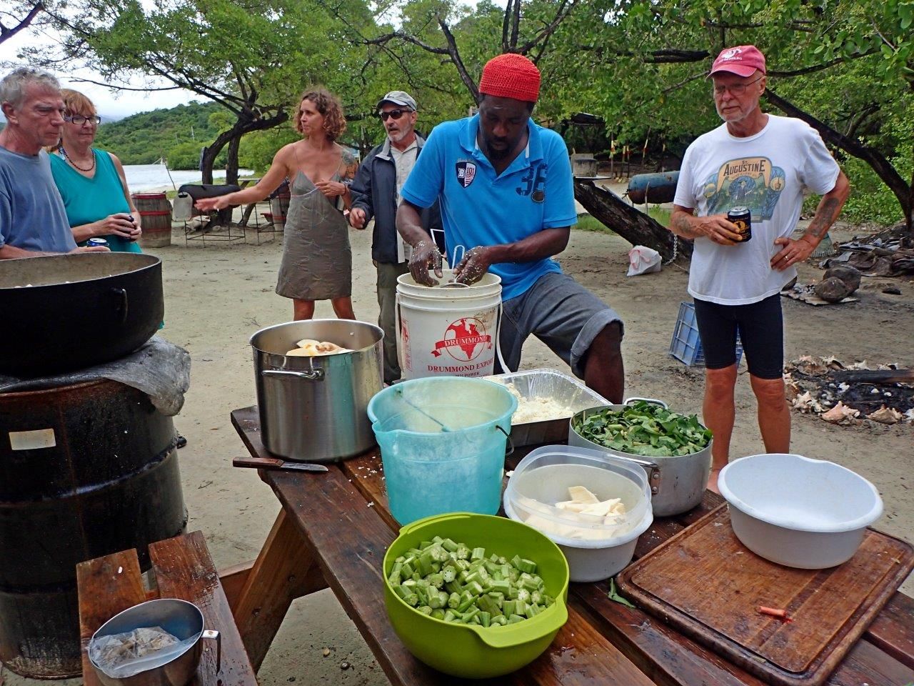 """Our local friend, Sperry, cooking the traditional Grenadian dish, """"Oil Down"""""""