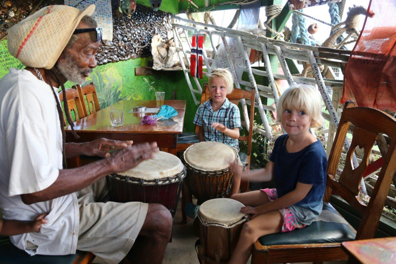 Roger, a colorful local character, teaching the kids how to bang the drums