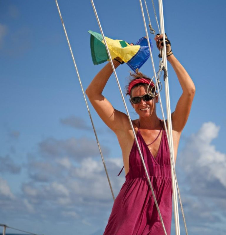Lowering the St. Vincent flag as we sail north to St. Lucia